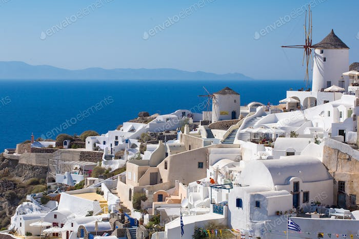 The Windmill in Oia and the Aegean Sea in Greece