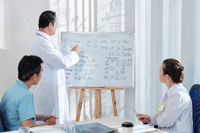 Discussing surgery timetable