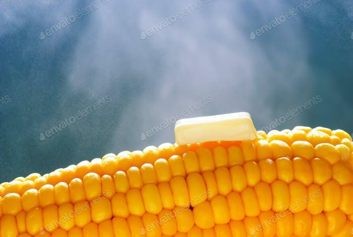 Melting butter on steaming got corncob
