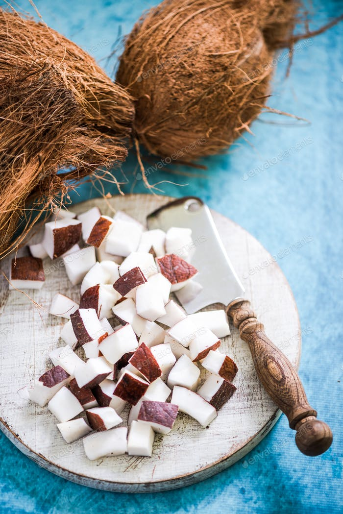 coconut pieces and whole nuts