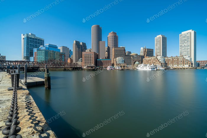 Boston skyline from Fan Pier at the afternoon with smooth water river, Massachusetts