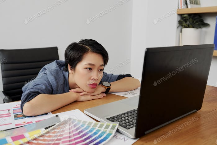 Web designer reading e-mail with corrections
