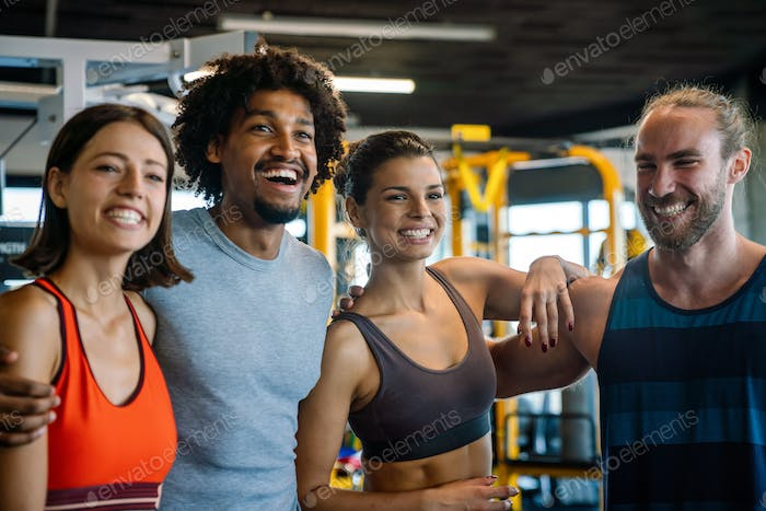Sport gym exercise and people concept. Happy fit people working out in gym