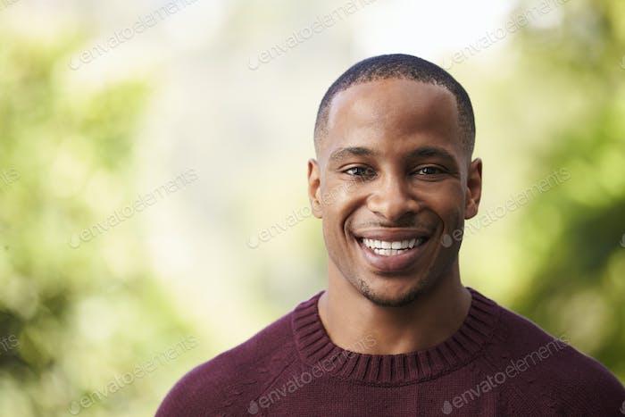 Outdoor Head And Shoulders Portrait Of Man