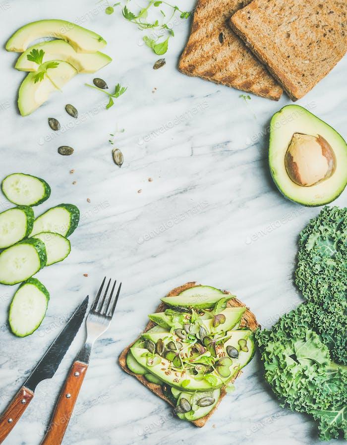 Breakfast with avocado, cucumber, kale, kress sprouts, pumpkin seeds sandwich