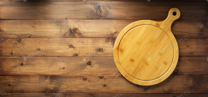 pizza or bread cutting board at wooden table