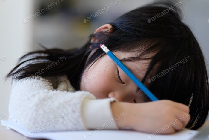 Asian young child fall asleep during study