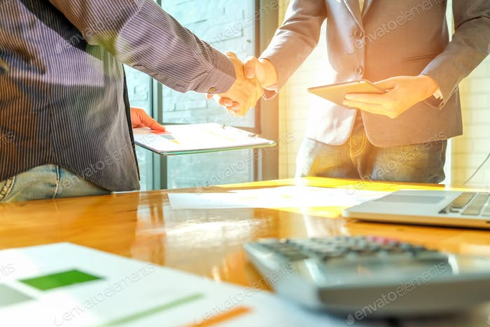 Businessmen shake hands when entering into business deal,In the