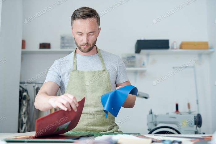 Clothier working in workshop