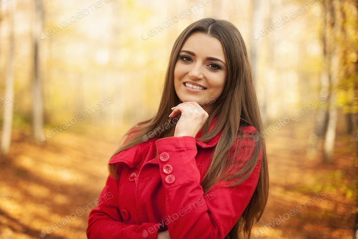 Portrait of beautiful woman in autumn time
