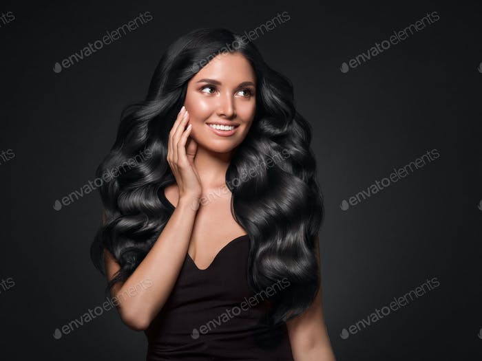 Black hair woman long curly beauty cosmetic concept over black background
