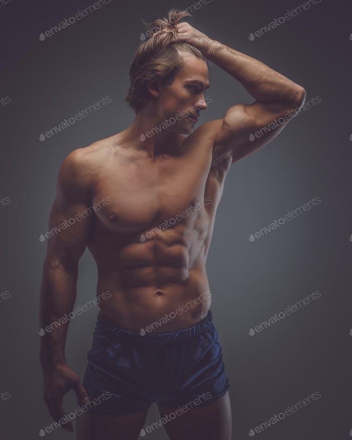 Shirtless muscular man in a shorts.
