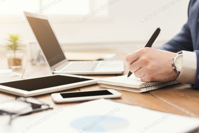 Unrecognizable businessman typing on laptop