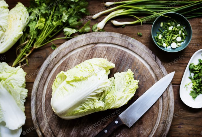 Aerial view of knife with fresh organic chinese cabbage