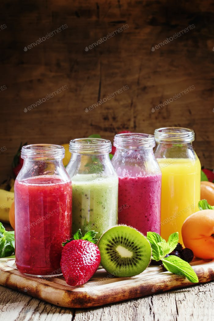 Several bottles with fruit and berry juices