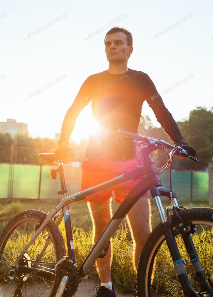 Mountain bike cyclist riding at sunrise healthy lifestyle doing
