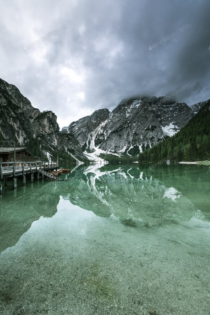 Moody image of Pragser Wildsee or Braies Lake in Italy.