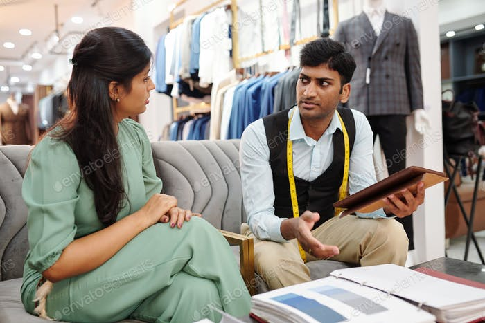 Tailor and client discussing fabric