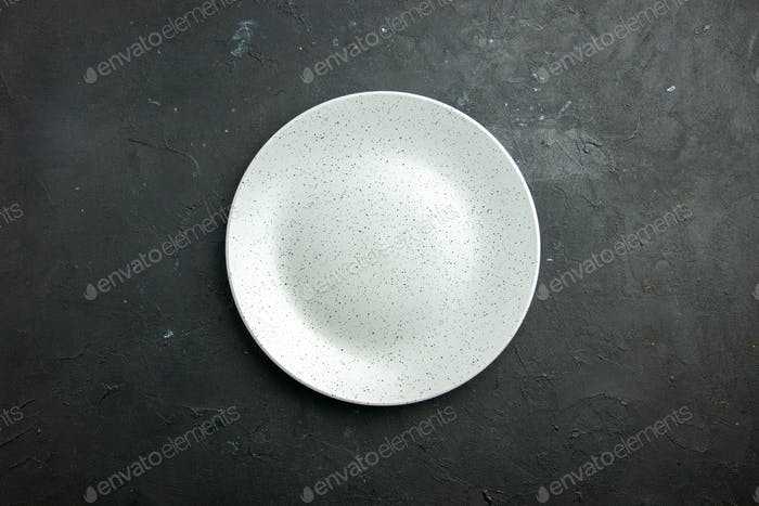 top view white round plate on dark background with copy place