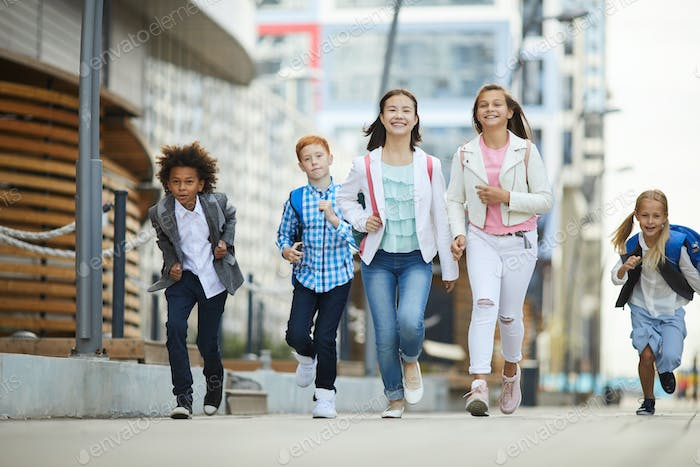 Group of children rushing to school
