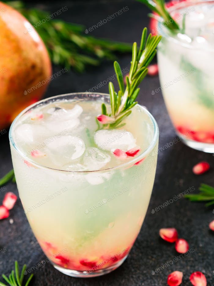 white sangria with rosemary, pomegrante and lemon juice