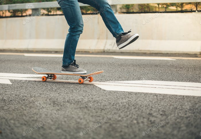 Riding skateboard on road