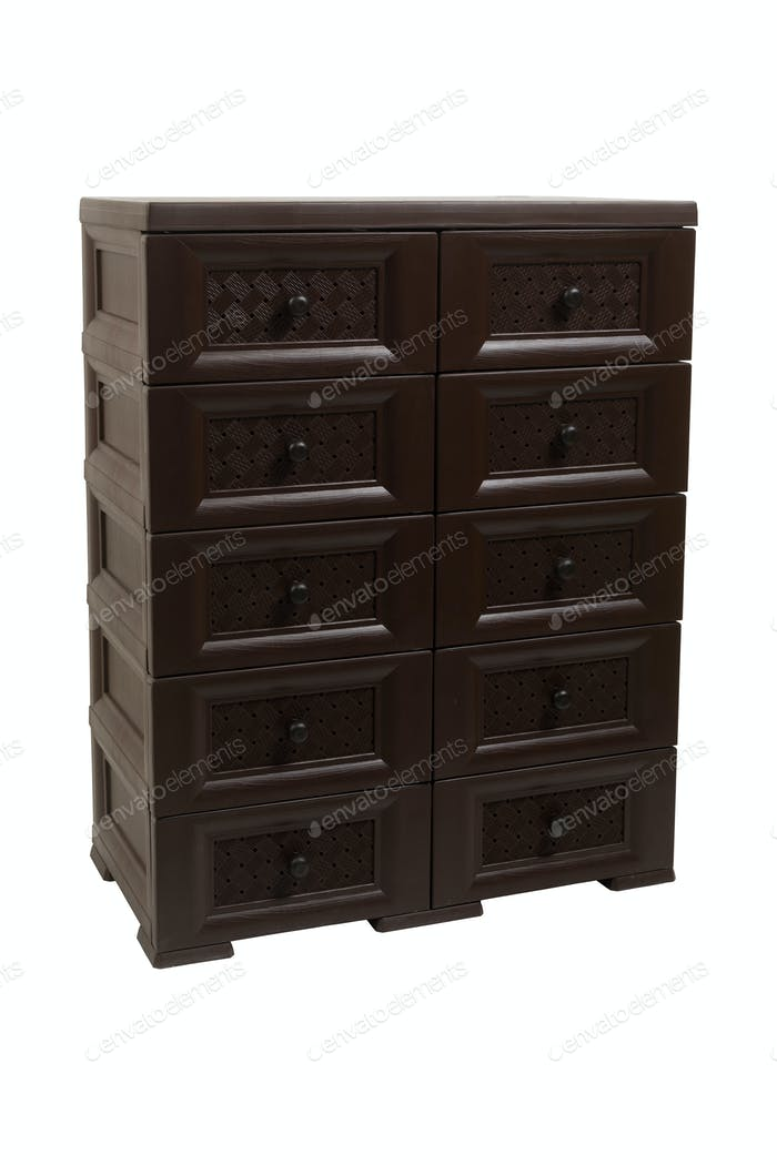 Plastic brown chest of drawers on a white isolated background