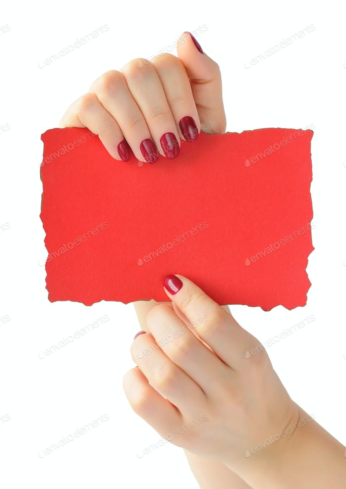 Hands holding red paper isolated on white background. Empty blan
