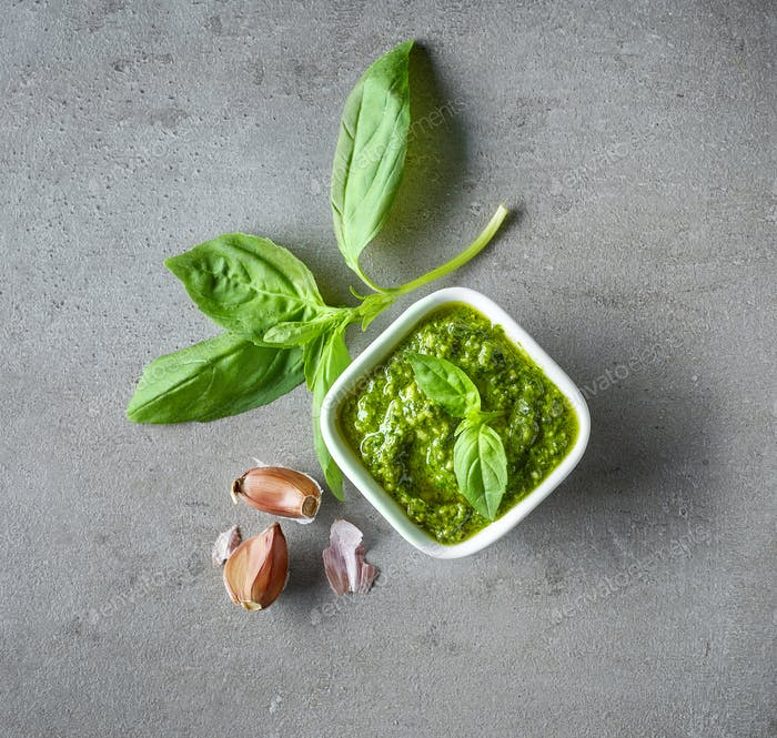 Pesto sauce on grey table