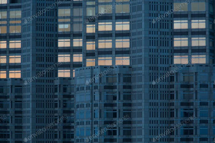High rise building reflected in another in Shiodome district Tokyo. Japan