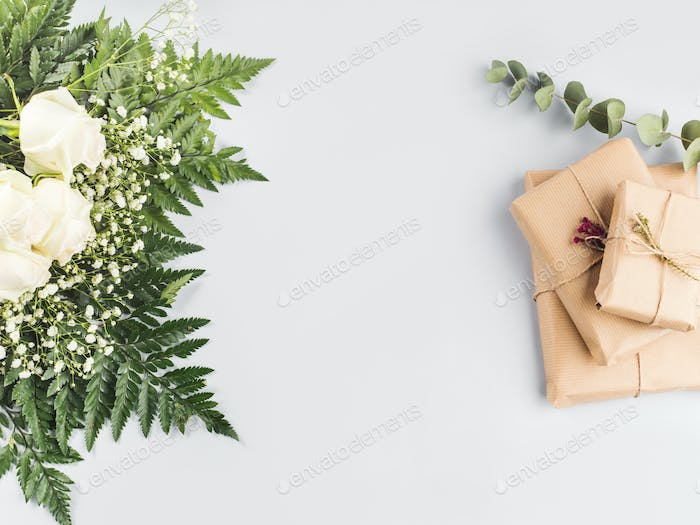 White roses bouquet as gift on a holiday on gray
