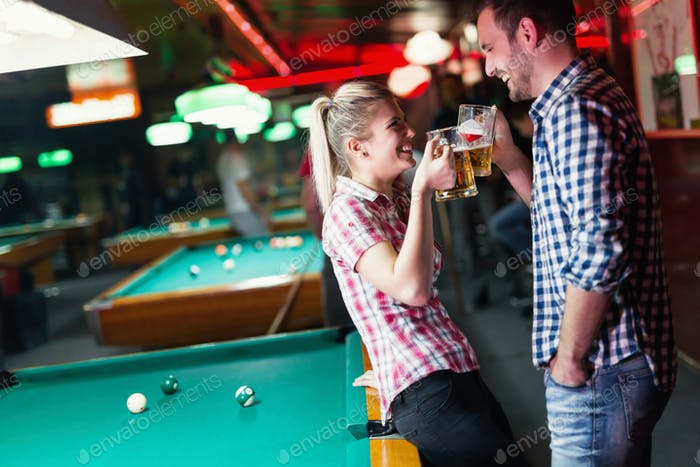 Young couple on date at snooker club