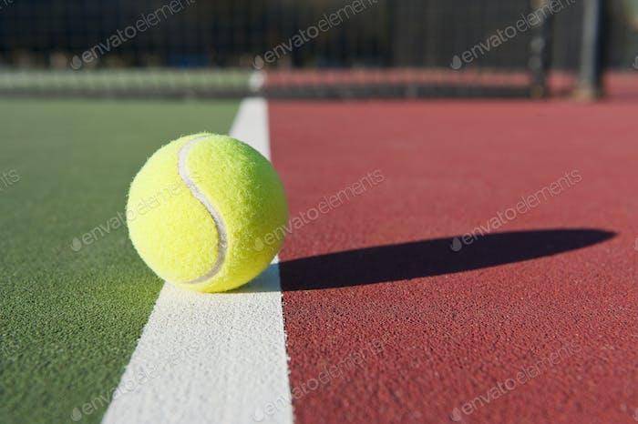Tennis Ball Sitting on Court