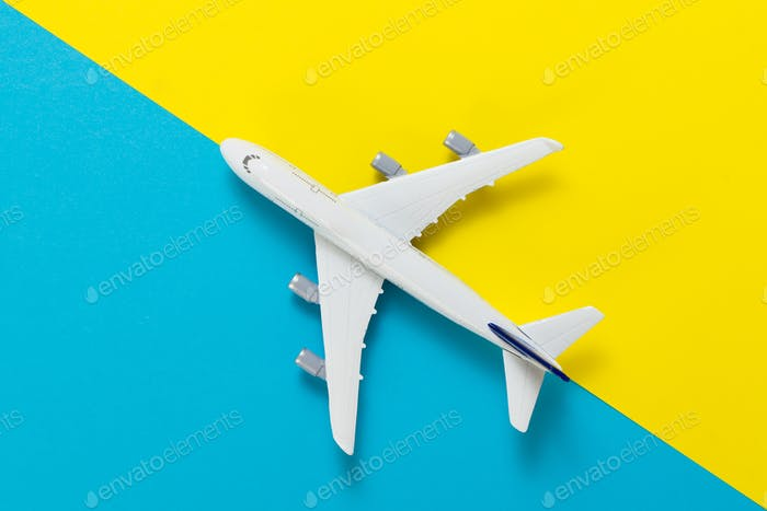 Miniature airplane travel theme