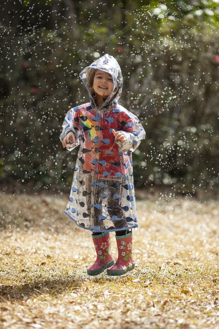 little girl jumping in the rain
