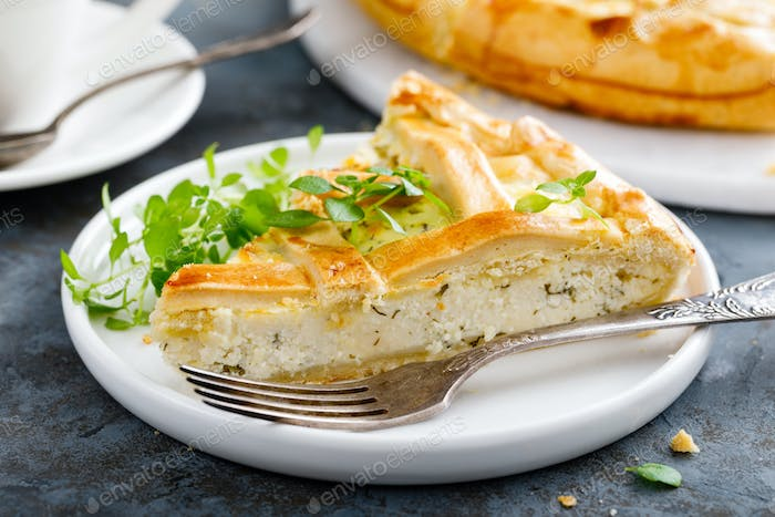 Pie with salted soft cheese and greens