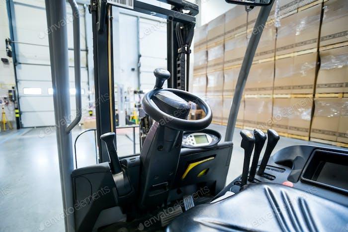 Forklift steering wheel in warehouse