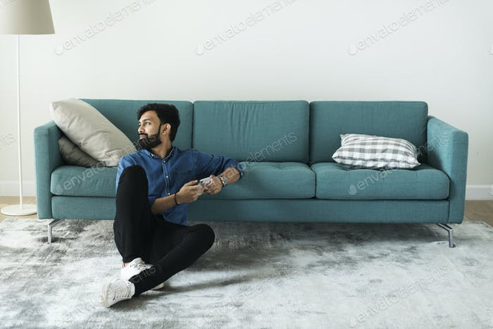 Man using mobile phone on the floor alone