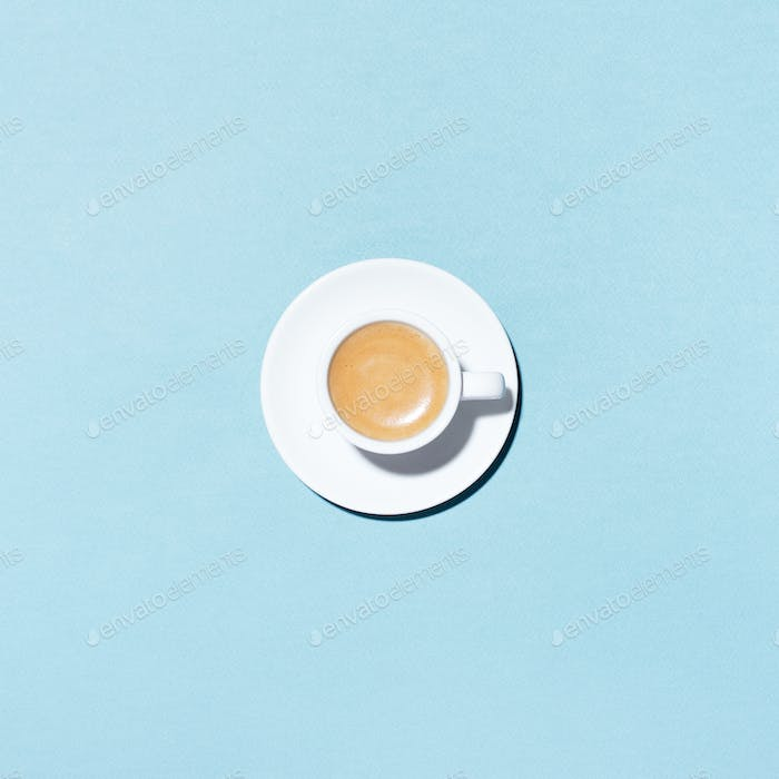 A Cup of Coffee on Blue Background.
