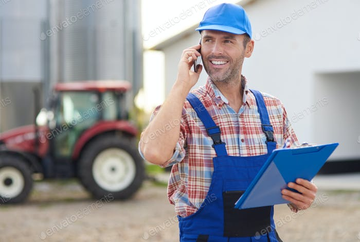 Farmer controlling his agricultural business