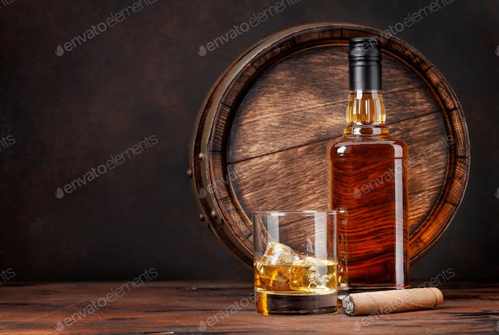 Scotch whiskey bottle, glass, cigar and old barrel