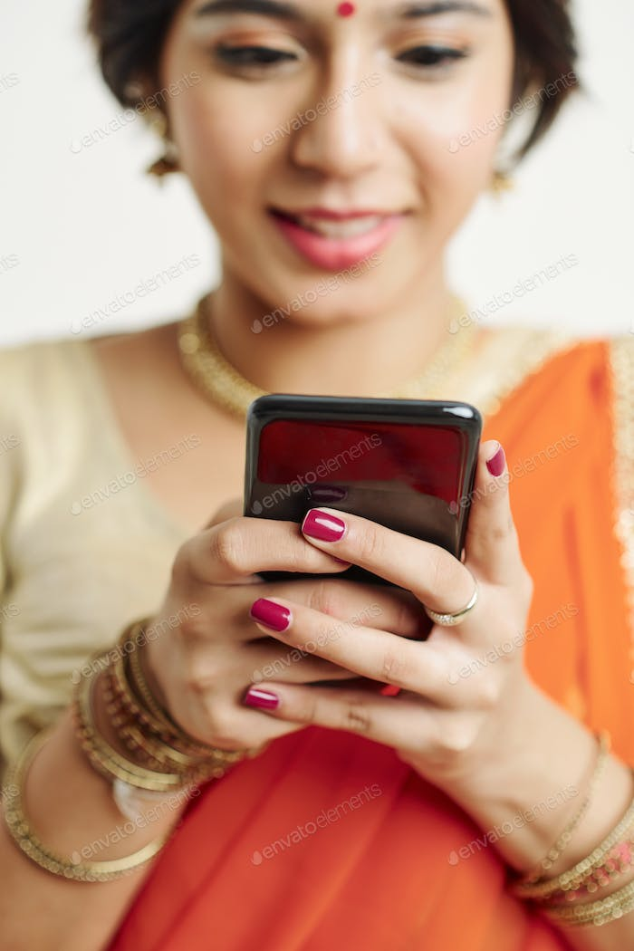 Texting Indian woman