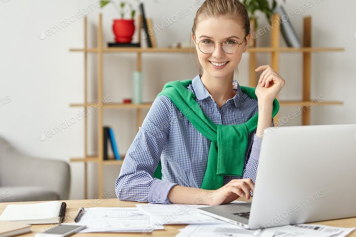 Successful freelancer works at home remotely, uses modern gadgets and free wifi connection. Professi