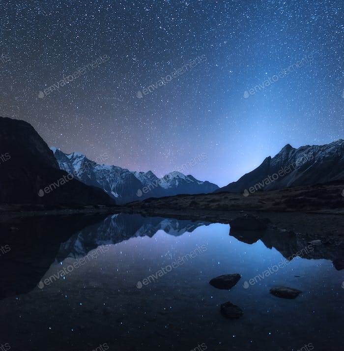 Amazing night scene with mountains and lake