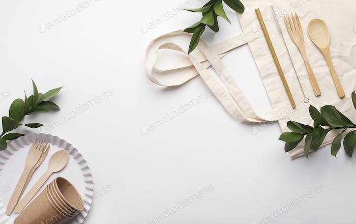 Natural eco-friendly disposable utensils on linen bag