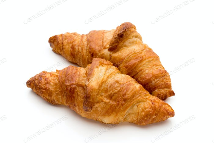 Tasty buttery croissants on the white background.