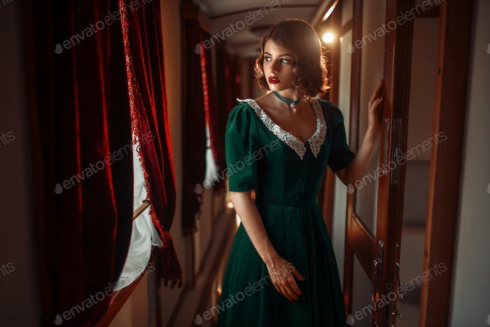 Railway journey, woman in retro train