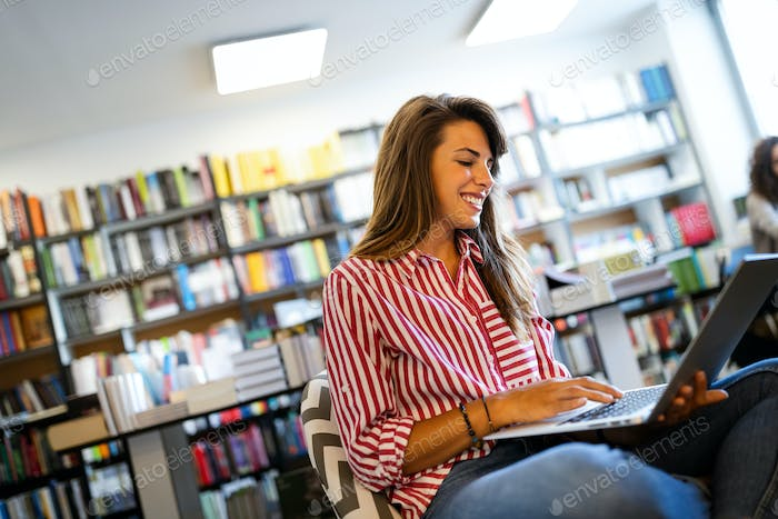 Beautiful happy woman using notebook. Study, learning, university concept