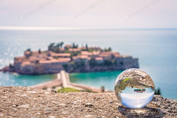 Sveti Stefan reflected in a glass ball