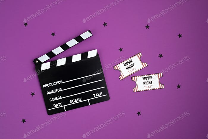 Movie clapperboard and cinema tickets. Home movie night, party invitation